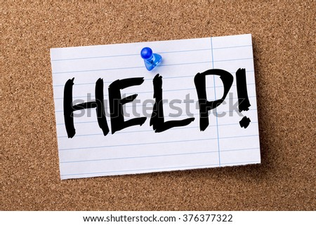 HELP! - teared note paper  pinned on bulletin board - horizontal image - stock photo