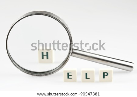 Help word and magnifying glass - stock photo