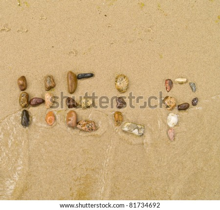 help written in pebbles on sea shore concept - stock photo