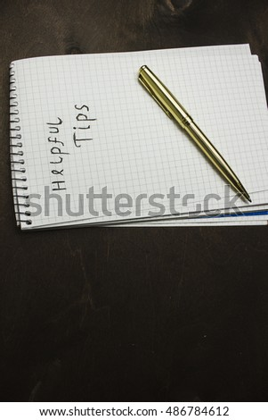 Helpful tips text write on paper as background