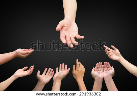 helping hand and hands praying on black background,helping hand concept.compassion and tenderness conception. - stock photo