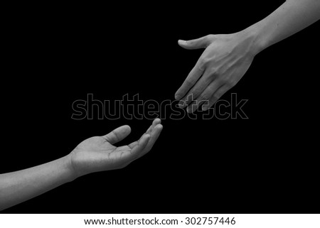 helping hand and hands praying on black dark background,healing hand concept. pray for paris conception:strong together conceptual:assistance/support:Memory of the Victims of the Holocaust concept.  - stock photo