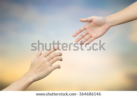 helping hand and hands praying on blurred beautiful sunrise sky backgrounds. healing hand concept.hand of god giving the power to human's.pray for violence country concept.keep calm and peaceful idea. - stock photo