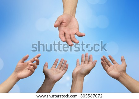 helping hand and hands praying on blurred blue color  background with circle light , helping hand concept. - stock photo