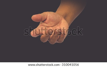 helping hand on black background  - stock photo
