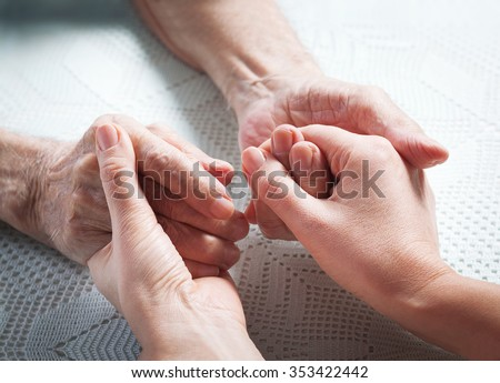 Helping hands, care for the elderly concept. Care is at home of elderly. - stock photo