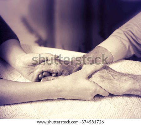 Helping hands, care for the elderly concept, man's hands black and white , - stock photo