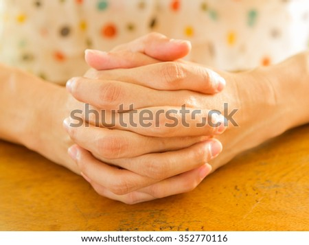 Helping hands for hope on background. - stock photo