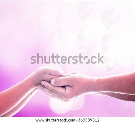 Helping hands. Two, Human Right, Heart, Child, Abuse, Awareness, Autism, Disease, Helping, Homeless, Stop, Suicide, Abstract, Pink, Purple, Violet, Save, Fund, Cure, Aids, Unity, Trust, CSR concept. - stock photo