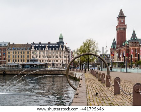 HELSINBORG, SWEDEN - MAY 4, 2015: The fountain on the embankment and Town Hall