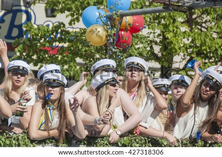 HELSINGBORG, SWEDEN - JUN 05: Graduates from different schools take part in a celebration parade throught the town centre on June 05, 2015 in Helsingborg, Sweden. - stock photo