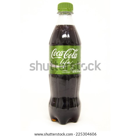 HELSINGBORG, SWEDEN - October 20th: Coca-Cola life bottle Isolated On White Background. Coca-Cola is a carbonated soft drink sold in shops, restaurants, and vending machines around the globe. - stock photo