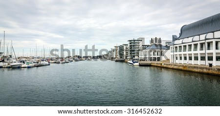 Helsingborg yacht harbor with city architecture - stock photo