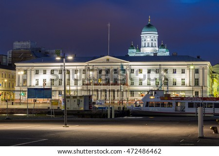 Helsinki, Finland - August 8, 2016: Scenic night view of the Old Town architecture and pier with Market Square and Lutheran Christian Cathedral Church at the Senate Square in Helsinki, Finland