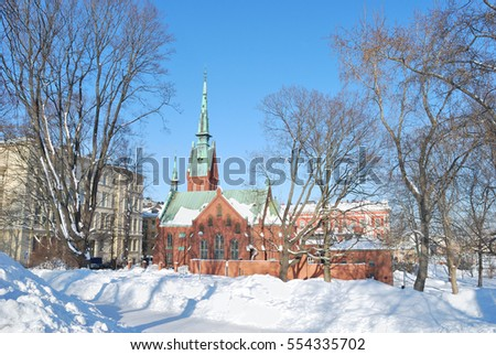 Helsinki, Finland. Beautiful  park and the German church in a sunny winter day