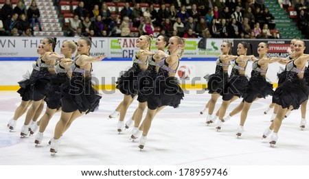 HELSINKI, FINLAND - FEBRUARY 23, 2014: Team Rockettes competes in Finnish Synchronized Skating Championships 2014  at the Helsinki Ice Hall. Team won silver. - stock photo