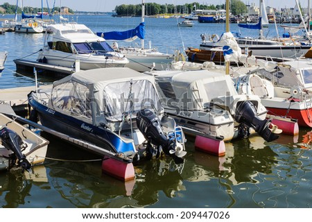 HELSINKI, FINLAND - JULY 26, 2014: Boats in Helsinki, Finland. Helsinki was chosen to be the World Design Capital for 2012