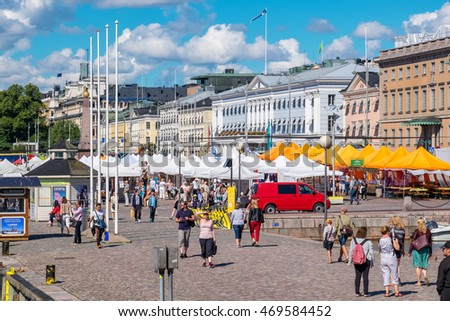 HELSINKI, FINLAND - JULY 19, 2016: Tourists visiting and shopping at Market Square near Helsinki Northern Harbour