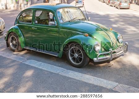 Helsinki, Finland - June 13, 2015: Green early 1966 Volkswagen Beetle car is parked on the street of Helsinki - stock photo