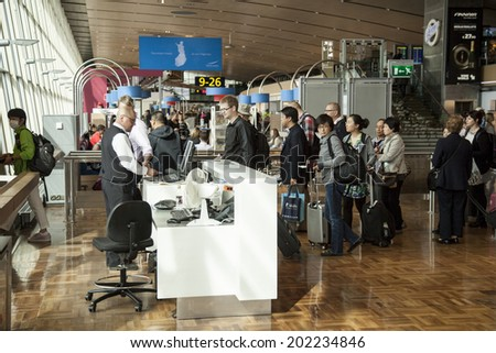 HELSINKI, FINLAND, 16 JUNE 2014: passengers on helsinki Vantaa airport boarding a flight - stock photo