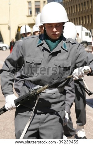 HELSINKI, FINLAND – JUNE 1: Young recruits in full uniform and battle gear get ready for military parade on June 1, 2007 in Helsinki.