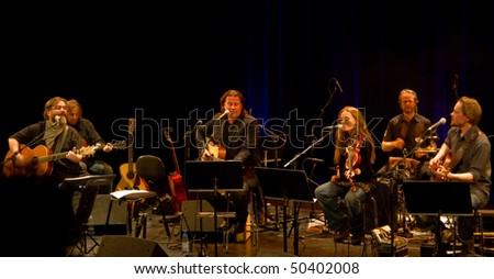 HELSINKI, FINLAND - MARCH 30: Finnish roots music band Hoedown and Kaartamo, Kettunen & Kuustonen live on stage at Malmitalo on March 30, 2010 in Helsinki, Finland - stock photo
