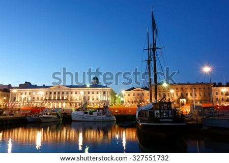HELSINKI, FINLAND - OCTOBER 7, 2015: Fishing boats and an old sailing boat at the Market Square (Kauppatori in Finnish) during the annual Helsinki Baltic Herring Fair (Silakkamarkkinat in Finnish). - stock photo