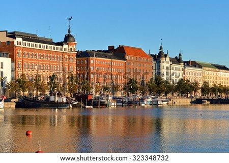 HELSINKI, FINLAND - SEPT 27, 2015:North Quay is located in center and runs along northern harbor. On waterfront there are houses built in different architectural styles in different historical periods