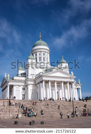 HELSINKI - MAY 15: Tourists visit St. Nicholas Cathedral with its 45 granite steps under a blue sky on May 15, 2013 in Helsinki, Finland