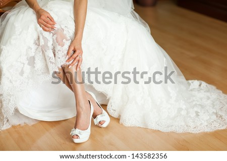 hem of her dress bride shoes lace train wedding dress