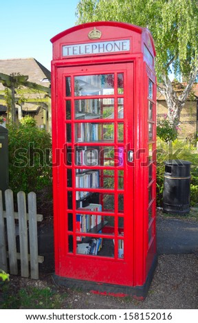 Hemingford Abbots. Cambridgeshire, England: September, 22nd, 2013: A old traditional English phone box converted into a book exchange - Library.  - stock photo