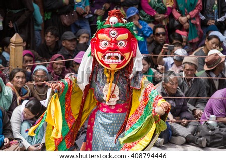 Hemis, India - June 29: unidentified monk performs a religious masked and costumed mystery dance of Tibetan Buddhism during the Cham Dance Festival on June 29, 2012 in Hemis monastery, India. - stock photo