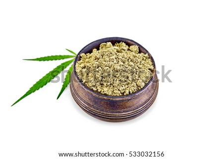 Hemp flour in a bowl, cannabis leaf isolated on white background