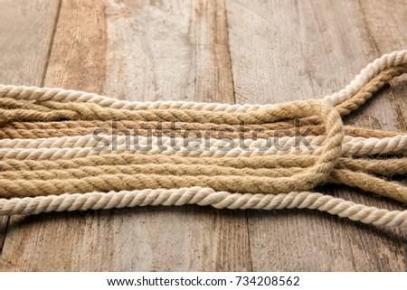 Hemp ropes on wooden background