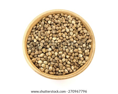hemp seed in a bowl on a white background - stock photo