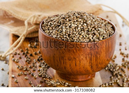 Hemp seeds on a wooden table. Selective focus - stock photo