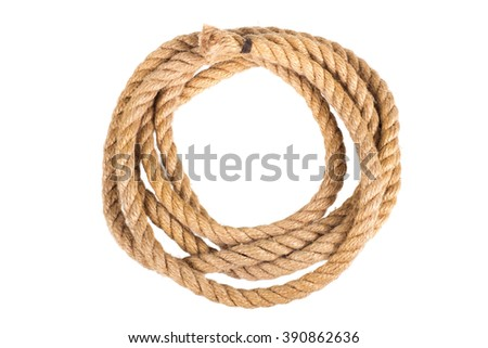 Hemp three strand rope coiled in a circular pattern isolated against a white background.