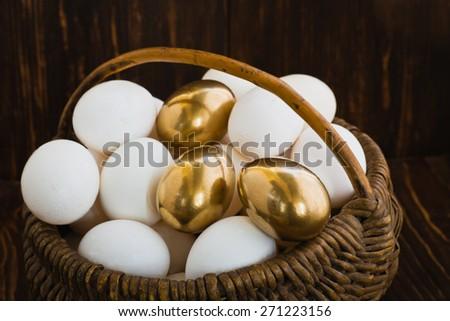 Hen laid golden eggs - stock photo