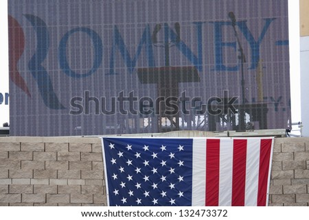 HENDERSON, NV - OCTOBER 23: US Flag under the sign for Governor Mitt Romney at the 2012 Republican Presidential Candidate ON October 23, 2012 in Henderson Pavilion, Henderson, Nevada. - stock photo