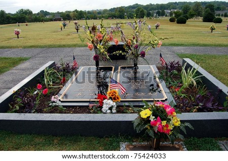 HENDERSONVILLE, TN - AUGUST 26: Fans leave flowers and other items of remembrance at the graves of singers Johnny Cash and June Carter Cash, August 26, 2008 at the Hendersonville Memorial Gardens, TN.