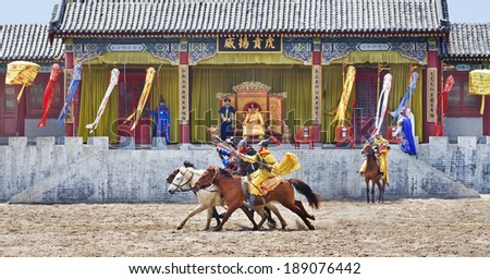 HENGDIAN-CHINA-APRIL 14, 2014. Ancient style horse show at Hengdian World Studios. With 495,995 sq. meter the largest movie town in Asia, construction began mid-1990s and has been ongoing ever since.