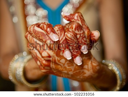 Henna On Hands Of Indian Wedding Bride - stock photo