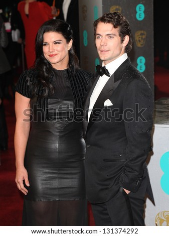 Henry Cavill and Gina Carano arriving for the 2013 British Academy Film Awards, at the Royal Opera House, London. 10/02/2013 Picture by: Alexandra Glen - stock photo
