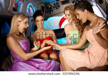 Hens night in limo with attractive young girls. - stock photo