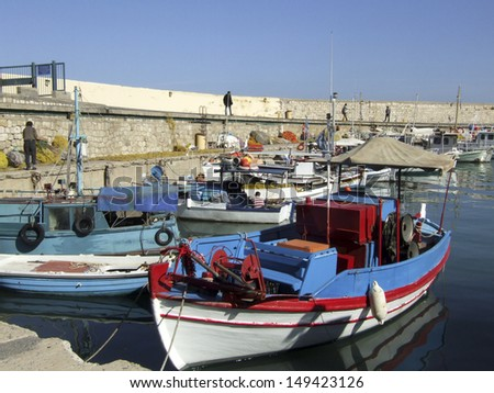 Heraklion harbour with fishing boats. Crete, Greece - stock photo