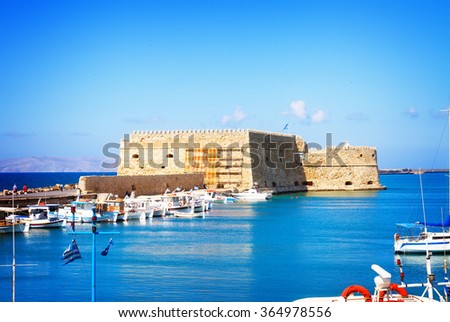 Heraklion harbour with old venetian fort, Crete, Greece, toned - stock photo