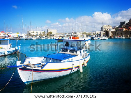 Heraklion old port with colorful boats, Crete, Greece, toned - stock photo
