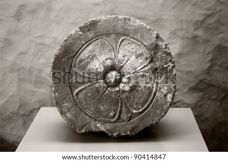 Heraldic stone carving from the medieval Livonia, Latvia - stock photo