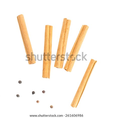 Herb and spice , Cinnamon and pepper on white background - stock photo