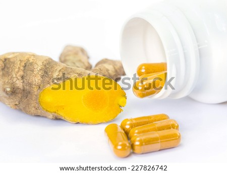 Herb capsule with bottle on white background  - stock photo